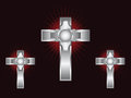 Three ornate silver crosses on a maroon background Royalty Free Stock Photography
