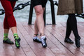 Three pair of female legs of dancers of the irish traditional dance on the wooden deck of embankment Royalty Free Stock Photography