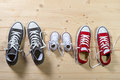 Three pair of shoes in father big, mother medium and son or daughter small kid size in family togetherness concept Royalty Free Stock Photo