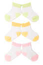 Three pairs baby socks Stock Photo