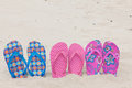 Three pairs bath slippers in a row Royalty Free Stock Image