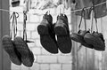 Three pairs old shoes hanging clothesline Royalty Free Stock Images