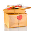 Three parcels with blank heart-shaped labels Stock Photography