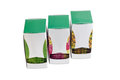 Three pasteboard boxes of tea bags with various green tea Royalty Free Stock Photo