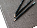 Three pencils on book a Royalty Free Stock Photos