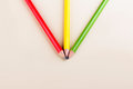 Three pencils colorful on paper background Royalty Free Stock Photos