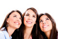 Three pensive women looking up isolated over white background Stock Photography