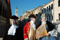 Three people in costumes at Carnival of Venice Royalty Free Stock Photo