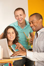 Three People Dining Out Using a Laptop Royalty Free Stock Image
