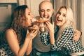 Three People Having Fun And Ea...