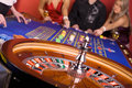 Three people playing roulette Stock Image