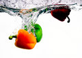 Three Peppers Splashed into Water Stock Images
