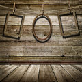 Three picture frame hanging on clothespins on a background of of wooden wall Royalty Free Stock Photography