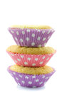 Three piled cupcakes isolated on white Stock Images