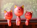 Three pink  cats on the shelf. Stock Photos