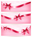 Three pink holiday banners with gift glossy bow an and ribbon vector Royalty Free Stock Images