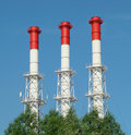 Three pipe heat and power plant red white Stock Photography