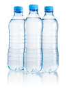 Three plastic bottle of drinking water isolated on white Royalty Free Stock Photo
