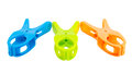 Three plastic spring clamps isolated over white background closeup of blue green orange Stock Photography