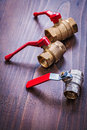 Three plumbers fixtures with red handles on Royalty Free Stock Photo