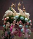 Unusual Christmas hanging wreath with plush swans. Royalty Free Stock Photo