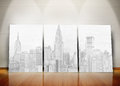Three posters representing a big city standing in line against wall Royalty Free Stock Photos