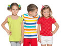 Three preschoolers with different emotions children are standing together on the white background Stock Photo