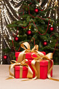Three presents with gold ribbon Royalty Free Stock Image