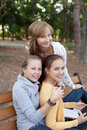 Three pretty student girls  urfing the internet Royalty Free Stock Photos
