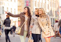 Three pretty women in the crowd crowdy place Royalty Free Stock Image