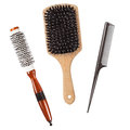 Three professional hairbrushes combs isolated Royalty Free Stock Photo
