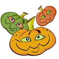 Three pumpkins cartoon with smiling faces over white Royalty Free Stock Photo