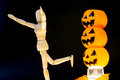 Three pumpkins scare wooden puppet away plastic Royalty Free Stock Images