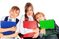 Three pupils group of smiling schoolchildren standing together and holding books isolated over white Royalty Free Stock Photo