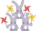 Three rabbits (hares) with spinners Royalty Free Stock Photography