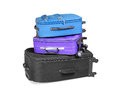 Three ready suitcases full and closed black blue and violet for the trip isolated on white background Stock Photography