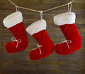 Three red boots christmas on the line Stock Image