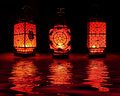 Three red chinese lanterns on black background Royalty Free Stock Photo