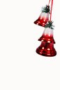 Three red Christmas bells. Royalty Free Stock Photo