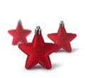Three red christmas decoration stars on white background Royalty Free Stock Photo