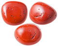 Three red coral gemstones isolated on white Royalty Free Stock Photo