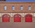 Three red doors and four windows fire squad station germany central europe Stock Image