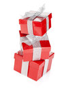 Three red gift boxes with silver ribbon and bow isolated on white background Royalty Free Stock Photography