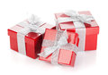 Three red gift boxes with silver ribbon and bow isolated on white background Stock Images