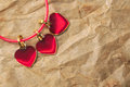 Three red hearts metal over brown grunge background Royalty Free Stock Image
