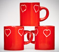 Three red mugs with love signs Royalty Free Stock Photo