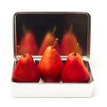 Three red pears in metal box Royalty Free Stock Photography