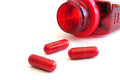 Three Red Pills (Capsules) & Prescription Bottle Royalty Free Stock Photo