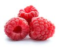 Three Red Ripe Juicy Raspberries Isolated on White Background Royalty Free Stock Photo