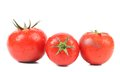 Three red ripe tomatoe isolated on a white background Stock Images